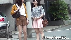 Petite Japanese girls are pissing in a public bathroom's Thumb
