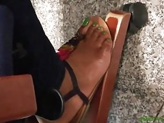 Candid ebony green toes at work