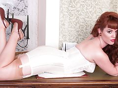 Redhead babe strip teases showing nyloned legs bare pussy