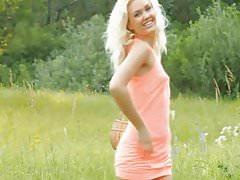 Fareza undresses in the fields