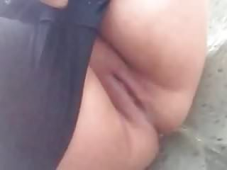 Close-up BBW with large bald pussy public street peeing 1