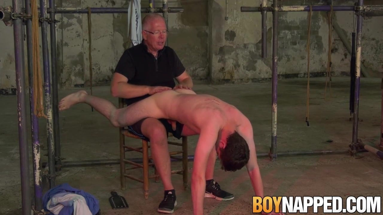 Younger twink slave Bob Metal receives ass spanking by outdated dom