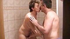 Midage couple in bathroom
