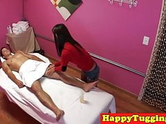 Petite asian masseuse jerking clients cock