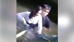 couple do romance in a river.mp4