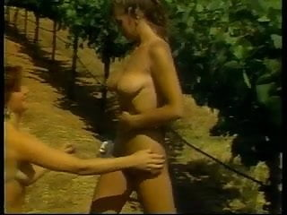 2 hot chicks with nice racks in lesbian action outdoors