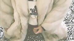 She male in fur coat