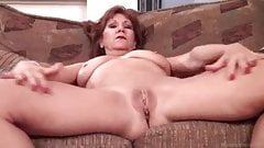 Mature Playing With Her Shaven Vagina