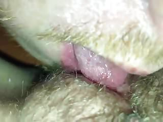Licking her into orgasm while he remains in chastity