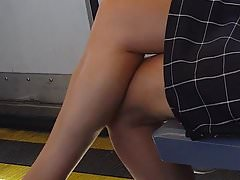 Sexy candid legs of MILF on train