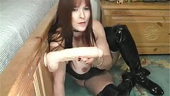 Horny chick plays with a big white dildo.
