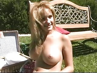 Busty brunette rubs her pink pussy at picnic