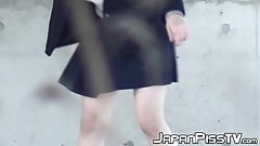 Naughty Japanese schoolgirls squirting piss in public