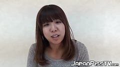 Tiny Japan babe covers the floor with her yellow juice's Thumb