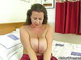 Busty and British milf Eva Jayne stuffs her fuckable cunt