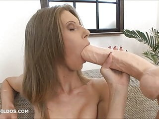 Skinny Blonde Stretching Her Pussy With A Big Dildo