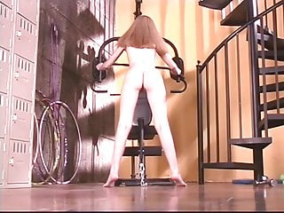 Flirtatious blonde in naked gym works out