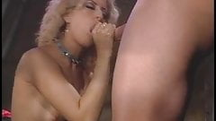Blonde tramp gets on her knees to eat cock