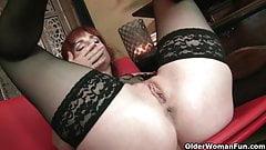 Redheaded milf Amber Dawn looks so slutty in black lingerie