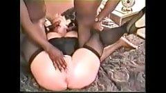 Mature blonde + stockings + 2 black bulls = fun