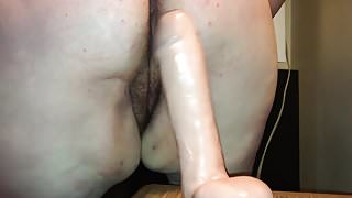 Riding a large dildo 1
