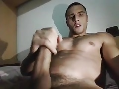 A gay with big cock cum on his body