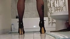 Man in heels plays with cock