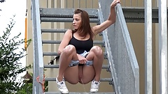 Fit Brunette Pees Down The Stairs