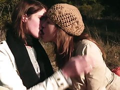 Horny brunette fucks her girl with strap on during a pic nic