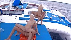 Two beautiful blonds on a boat