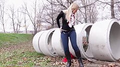 Blonde pisses on field behind concrete rings 25641's Thumb