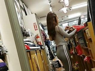 Teen shop assistant in leggings
