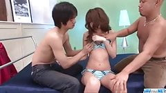 Cute Rika Kurachi enjoys two guys to pump her hard