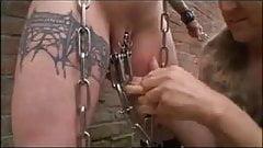 Busty tattooed slave outside