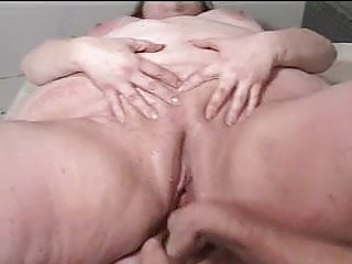 Amateur fatty squirts while fucked and fingered