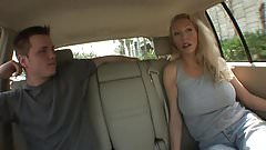 Blonde MILF with juicy tits sucks guy's tool in the car