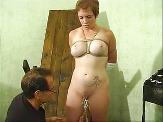Cute slut with a nice rack bound by her master for some fun