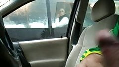 Flashing in car through the bus window