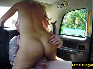 Busty english cabbie cockriding on backseat