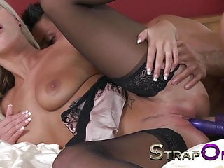 StrapOn Young blonde with big tits has both holes stretched