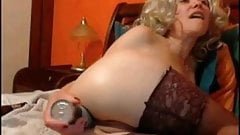 Amateur MILF with huge dildo and fisting