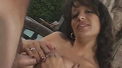 Exotic beauty wraps her large breasts around a throbbing cock