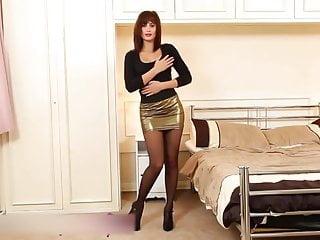 Sexy redhead secretary in mini skirt and pantyhose