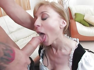 Busty mature maid dusts off his cock with her pussy