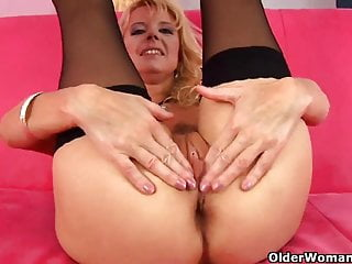Blonde grandma in black stockings fucks herself