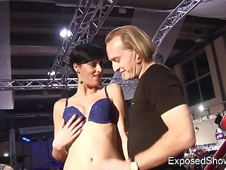 Hot slut playing with a rock hard cock at the sex show