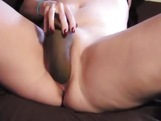 She enjoys a big black dildo in her pussy