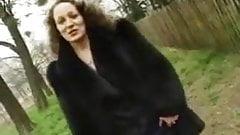 Mature in black fur coat
