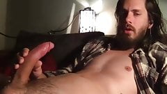 long haired guy jacking of and cums on cam
