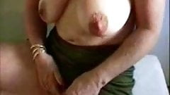 Hot granny stroking her big clitoris